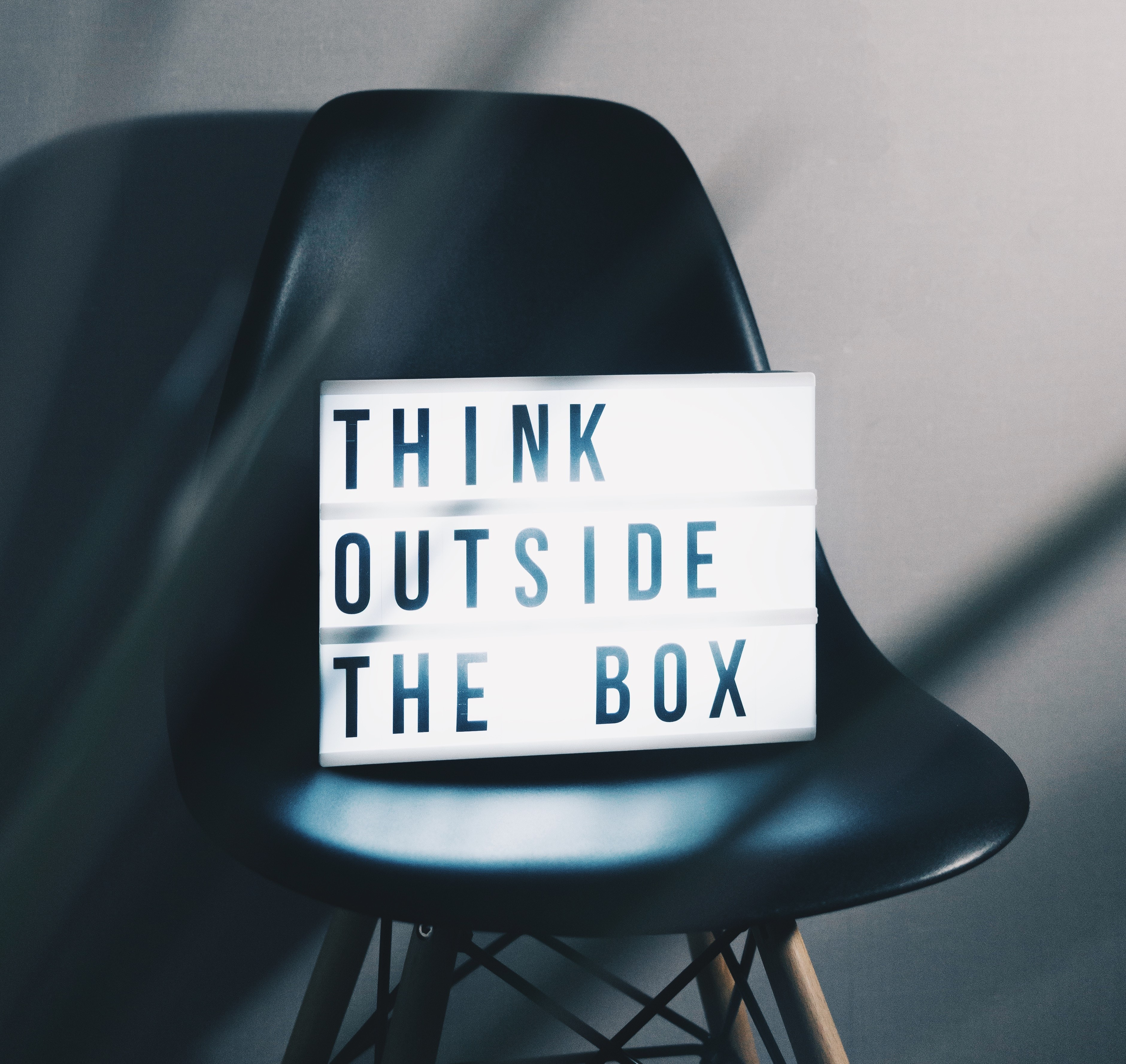 "Lightbox on chair showing ""Think outside the box"""